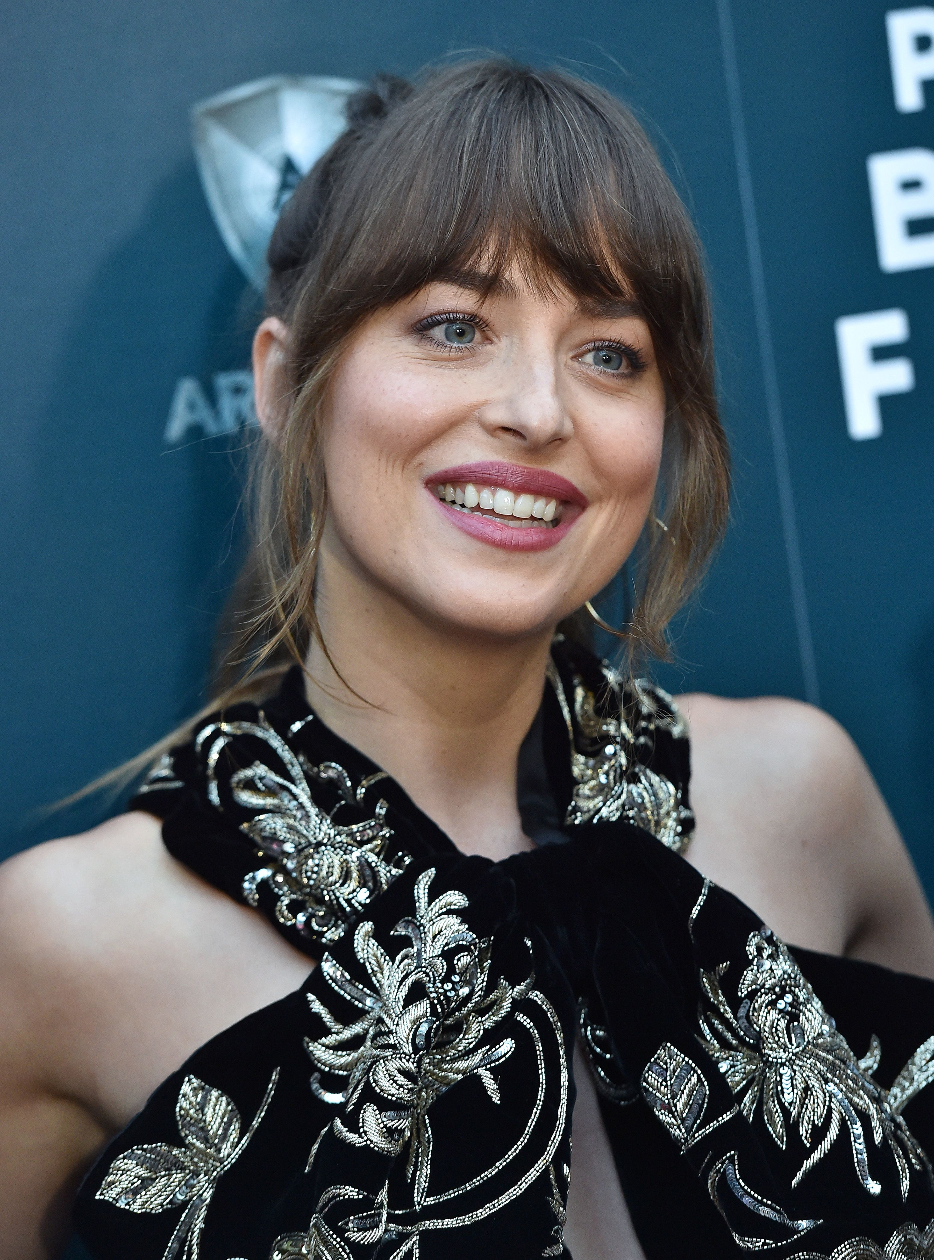 Twitter Is Freaking Out Over Dakota Johnson Closing Her Tooth Gap