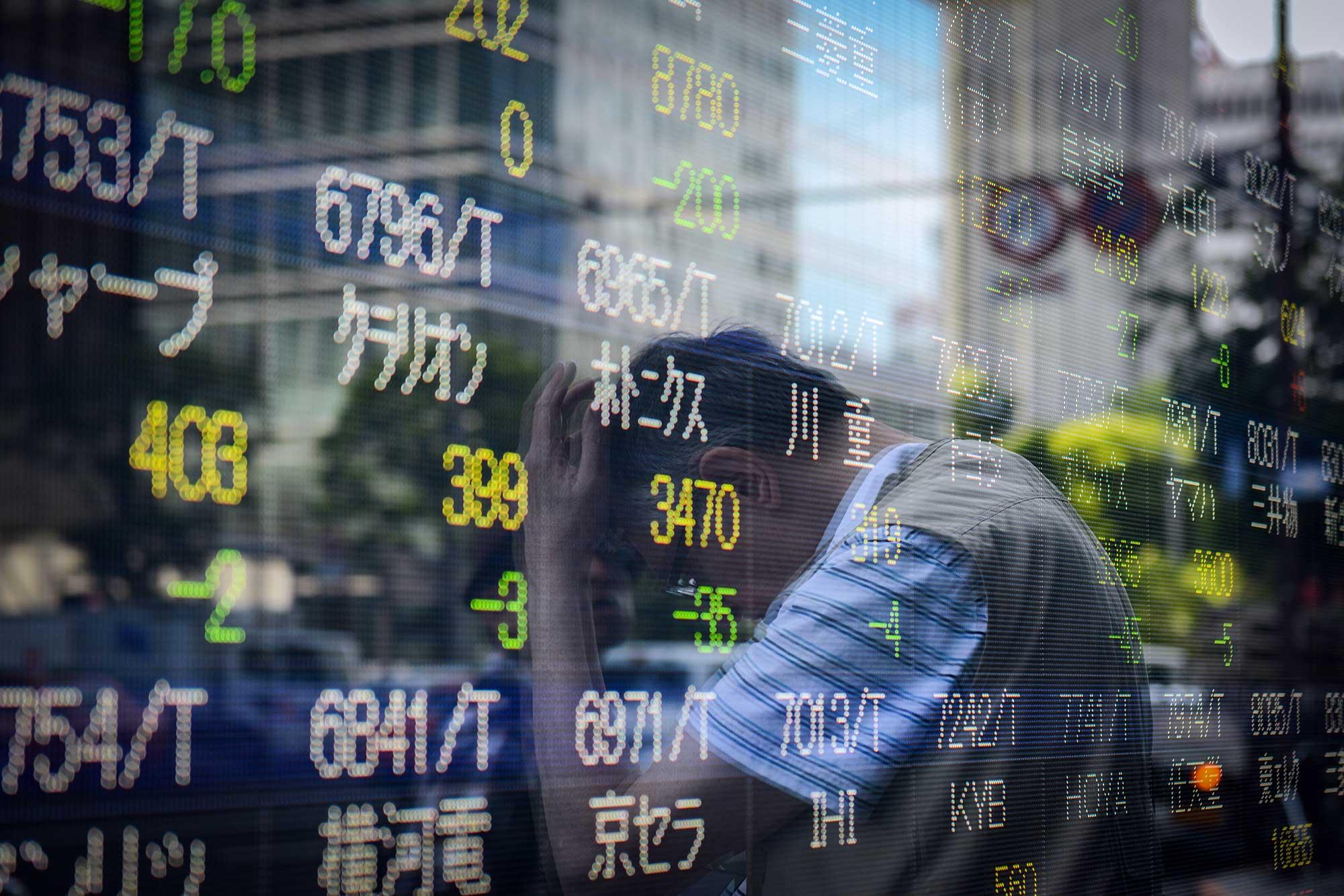 Japan stocks track Wall Street higher, but virus worries weigh