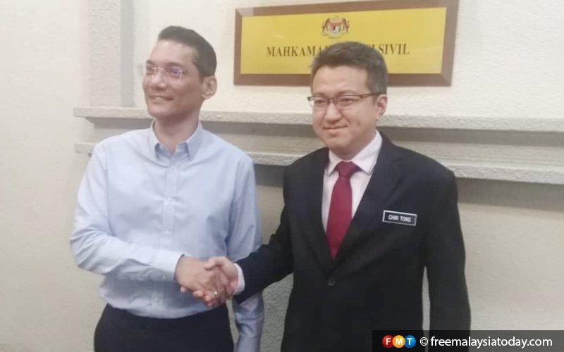 Chin Tong settles 'communist uniform' defamation suit