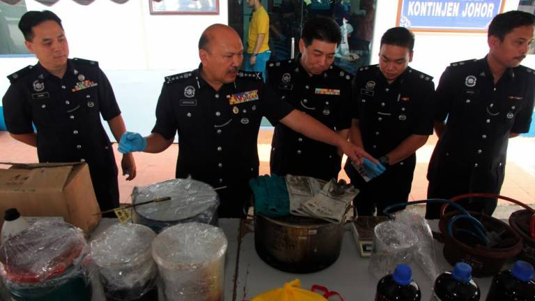 Police uncover drug processing lab on Mersing cattle farm