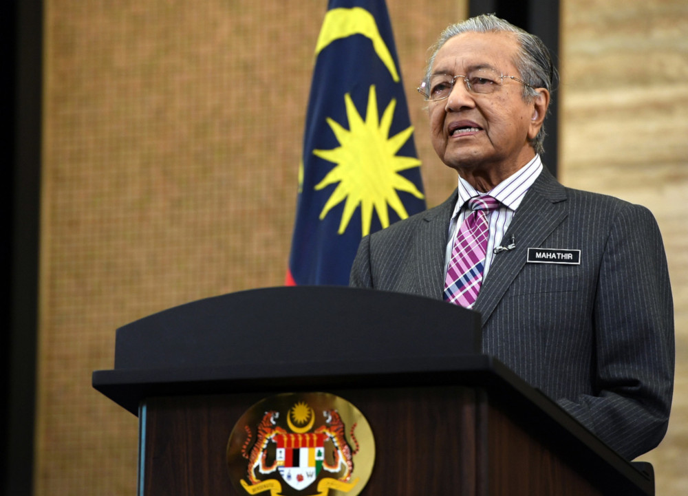 Keep improving yourselves to drive country forward, Dr M tells Malaysians