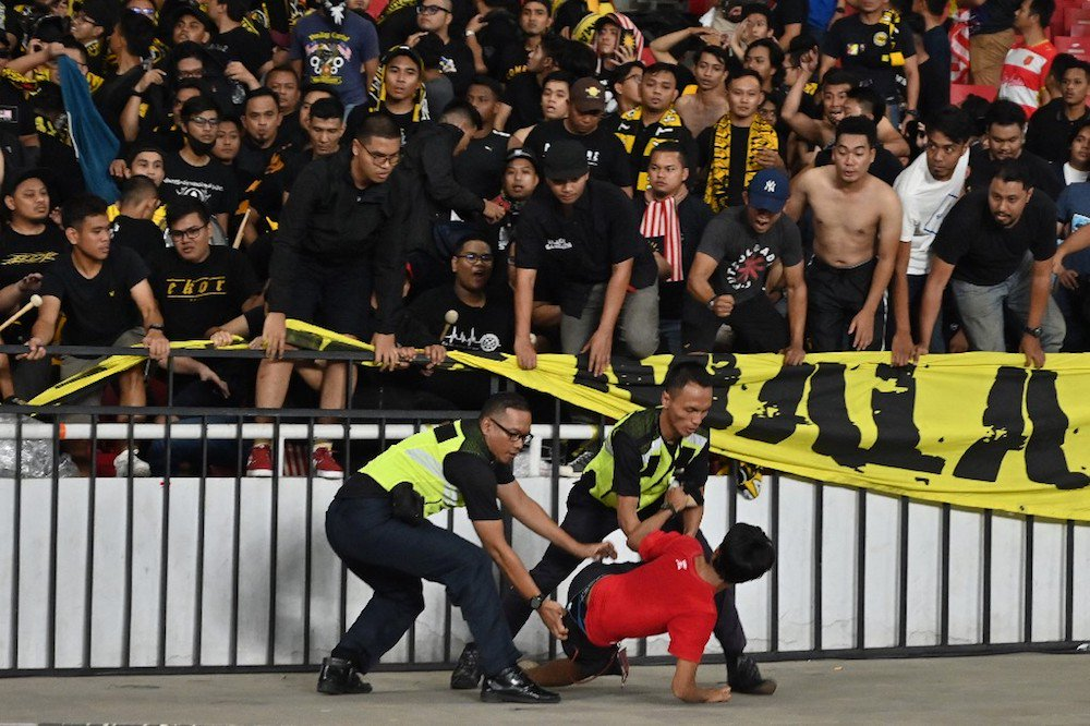 Malaysian Fans Attacked At FIFA Qualifiers After Harimau Malaya Bags Win Against Indonesia