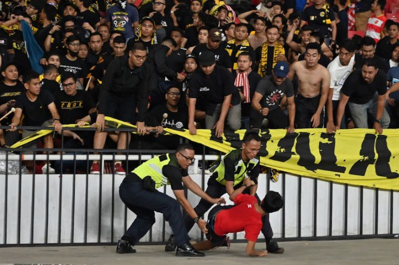 Sports minister demands 'justice' after Indonesia cop dismisses chaos over Malaysia win in World Cup qualifier