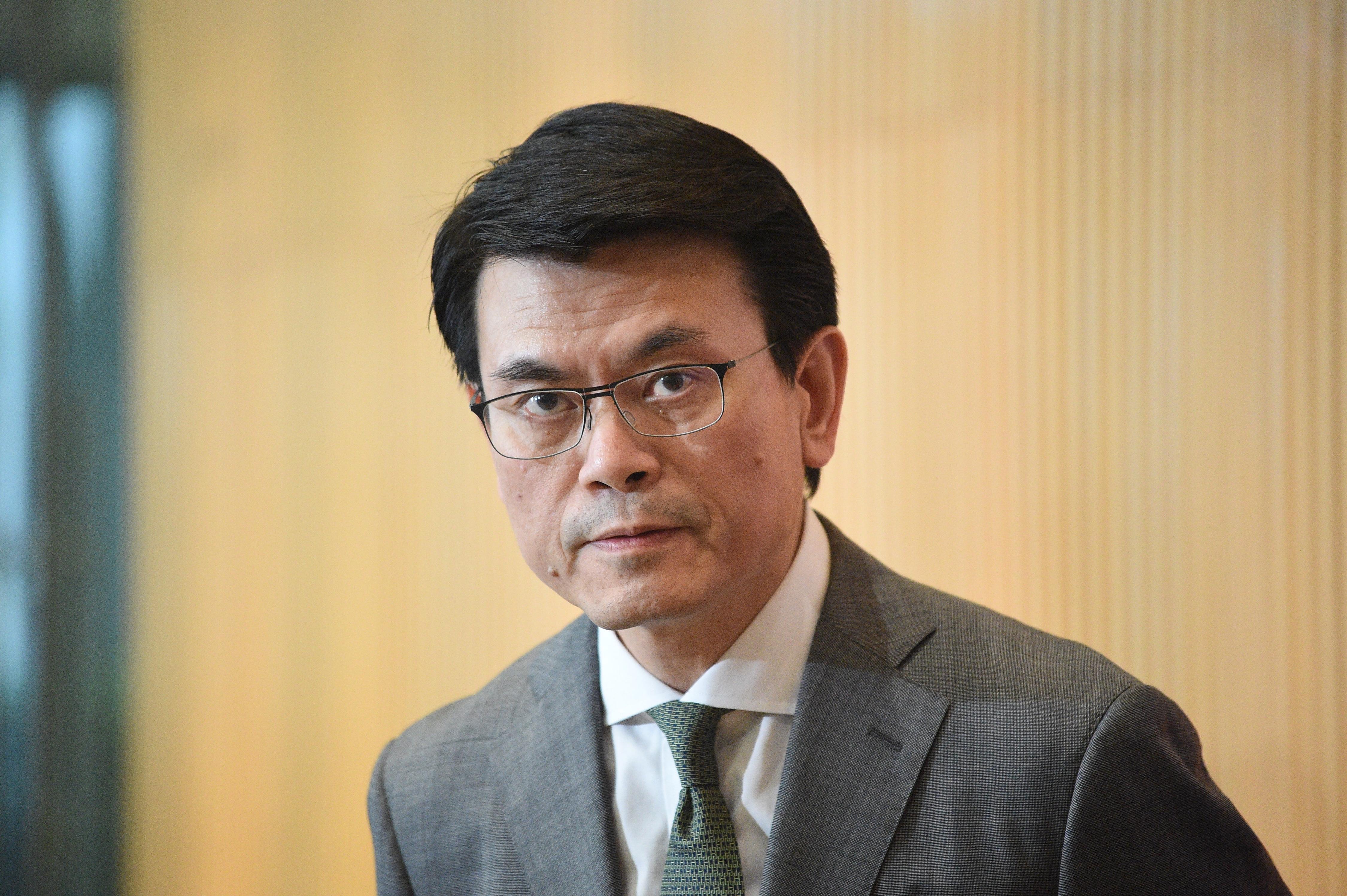 邱腾华:港贸易地位由基本法赋予 不受单一国家政策改变影响