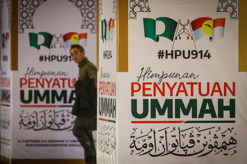 Umno, PAS supporters pack PWTC to witness union of once-bitter enemies