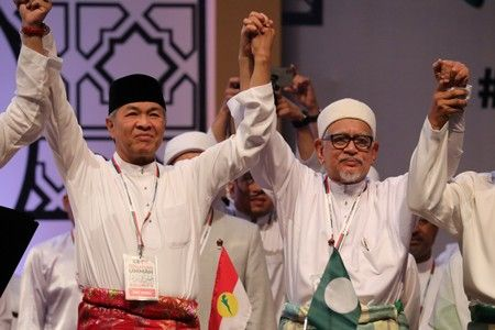 In push for race and religion, Malaysian opposition formalises pact