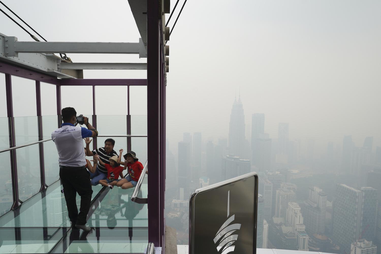 Indonesia seals off plantations as haze spreads