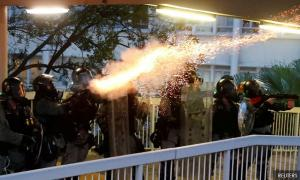 Hong Kong on edge as police fire tear gas at university campus