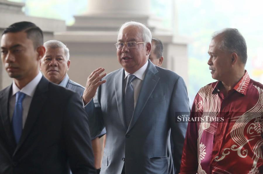 Jho Low prepared report on China trip, says Najib's ex-special aide