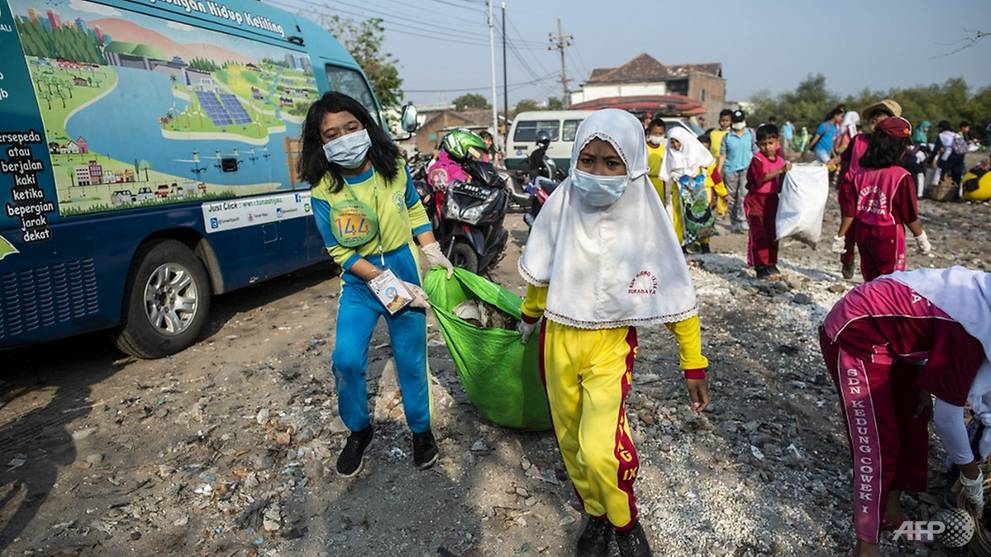 Activists across Asia get down and dirty clearing rubbish on mass cleanup day