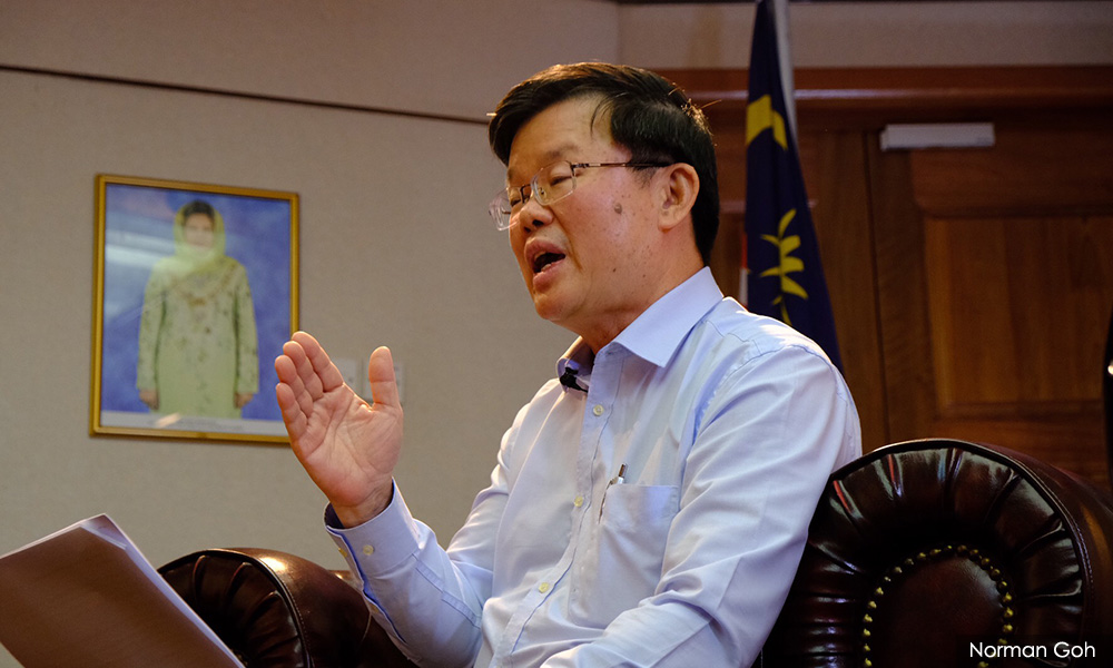 Aide lodges police report over claim Penang CM ordered MyKad for foreigners