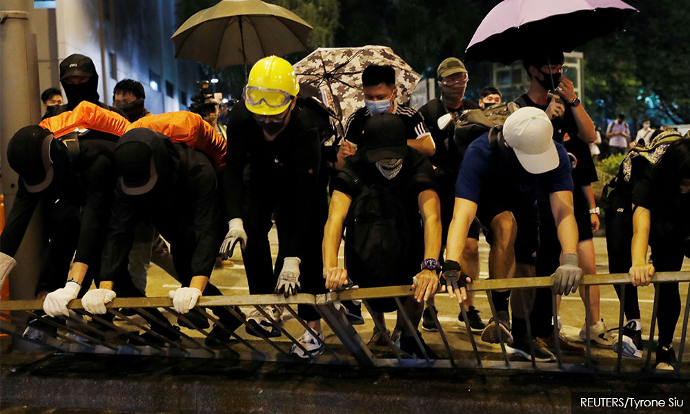Hong Kong police fire tear gas, water cannon to halt protest