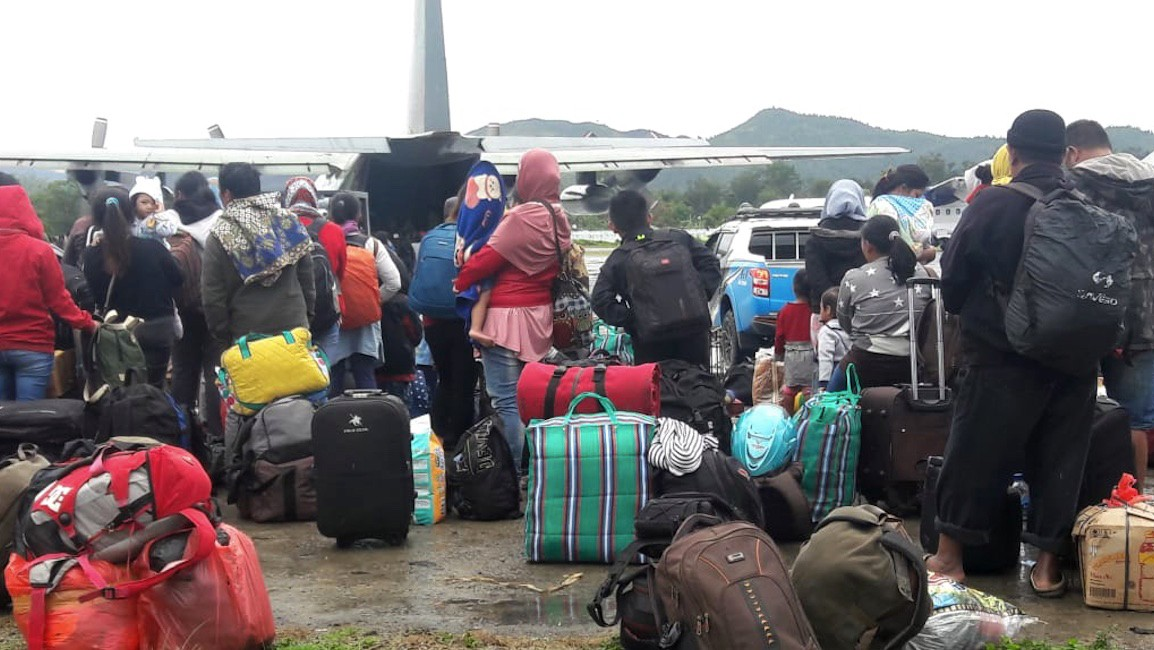 Good neighbors: Papuans help non-natives flee violence in Wamena