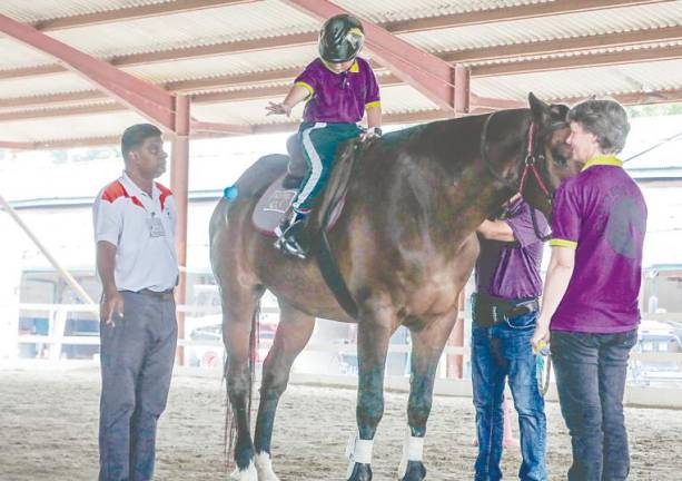 Ex-navy officer finds joy in giving horse-riding therapy for children with special needs