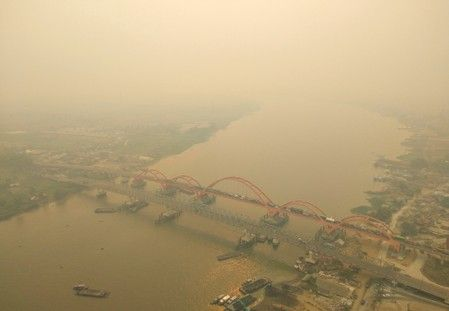 Indonesia shuts some schools as haze again clouds the skies