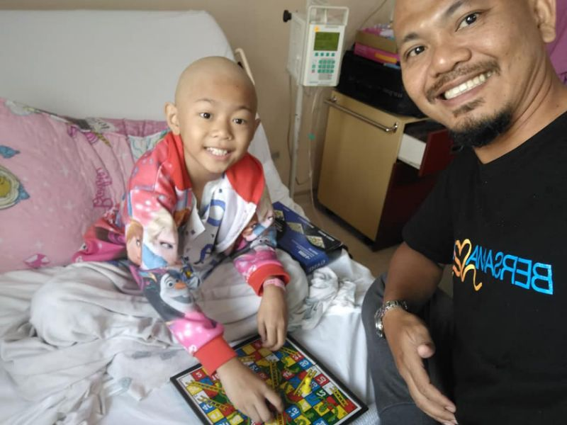 'Anything to cheer her up': Johor dad goes bald to support nine-year-old daughter with bone cancer