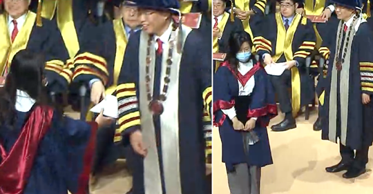 Hong Kong university official refuses to shake hands with students wearing masks during graduation ceremony
