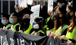 Hong Kong student who fell during protests dies, fresh unrest likely