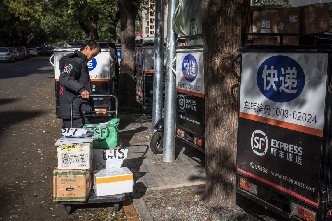 China's courier giants tackle Nov 11 Single's Day shopping sprees with automated logistics