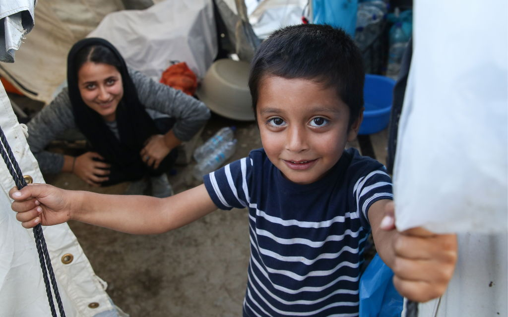 A refugee, a baby and the story that followed their chance meeting