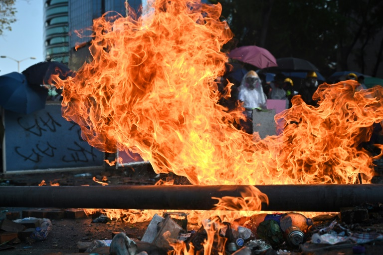 Fire holds off Hong Kong police at protest campus