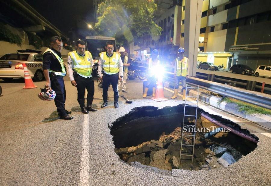 Car falls into sinkhole; driver unhurt