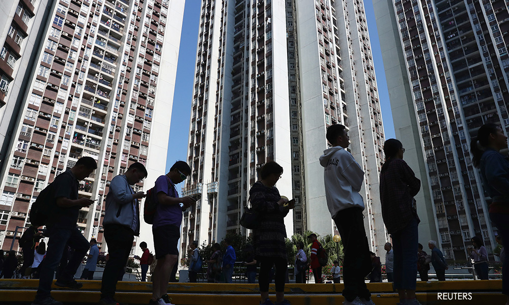 Landslide democratic win in Hong Kong election raises pressure on city's leader