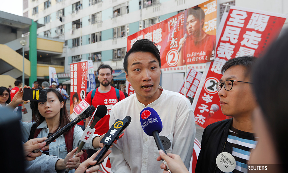 Hong Kong democrats cheer landslide victory in local elections