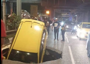 Massive sinkhole swallows car in heart of Kuala Lumpur