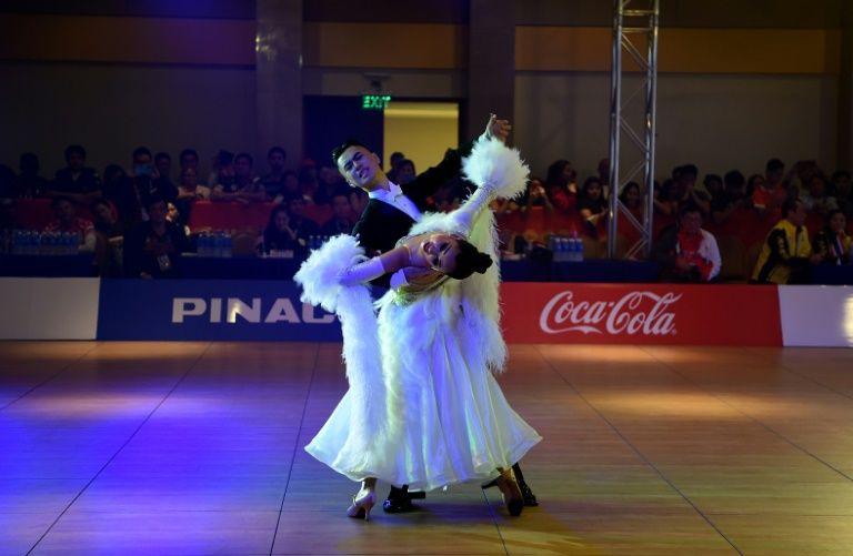 Glitz and glamour as dancesport waltzes into SEA Games
