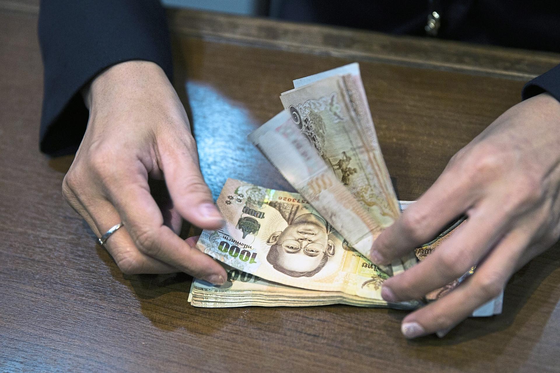 Thai premier says nation should 'spend in dollars' to weaken baht