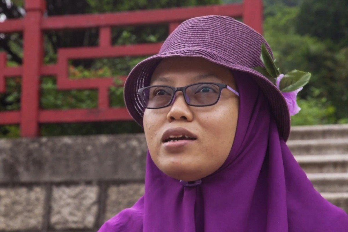 Immigration officials deport Indonesian domestic worker who covered Hong Kong protests as a citizen journalist and was arrested for overstay