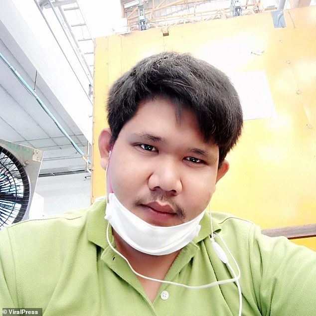 Man, 28, is electrocuted by his phone while playing with it as it's plugged into a charger at his home in Thailand
