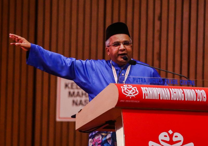 Umno delegate makes veiled claims that DAP sold IC to Chinese nationals