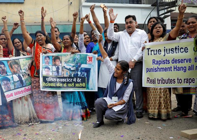 Indian police shoot dead 4 men accused of killing vet, drawing cheers