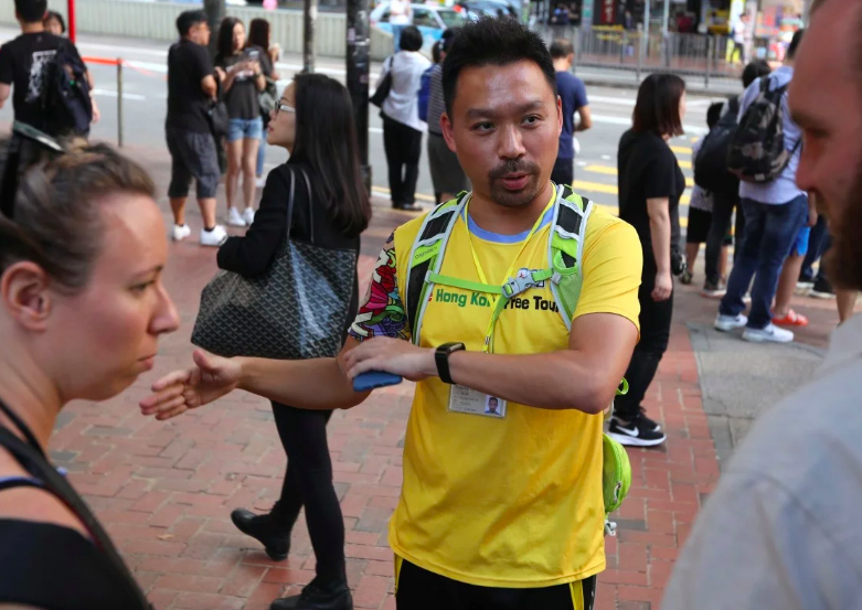 Not your usual day out for a tourist in Hong Kong: Curious visitors join walking tours to see protests