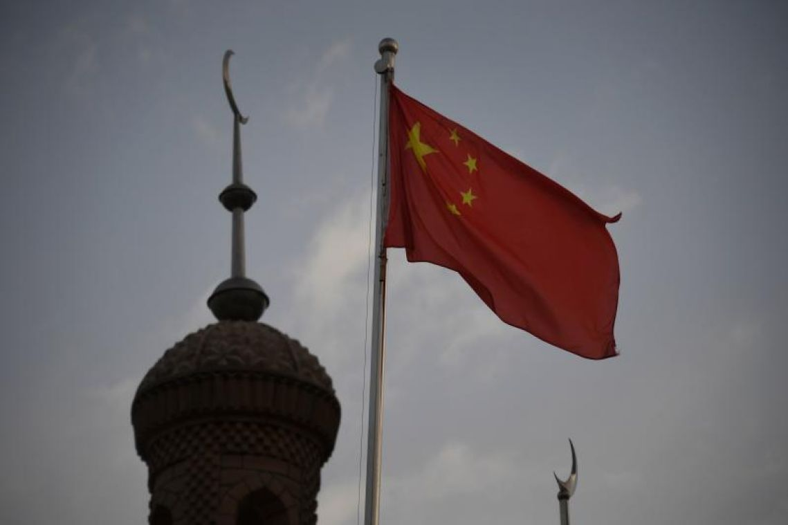 Chinese officials lash out at US over new legislation on Hong Kong, Xinjiang