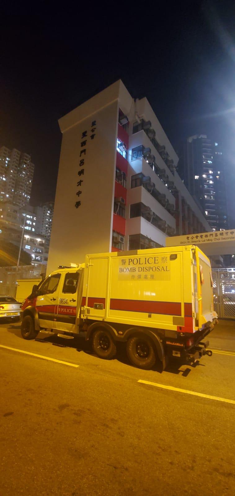 屯门爆炸品案疑犯为中学实验室助理 警方押解搜校园