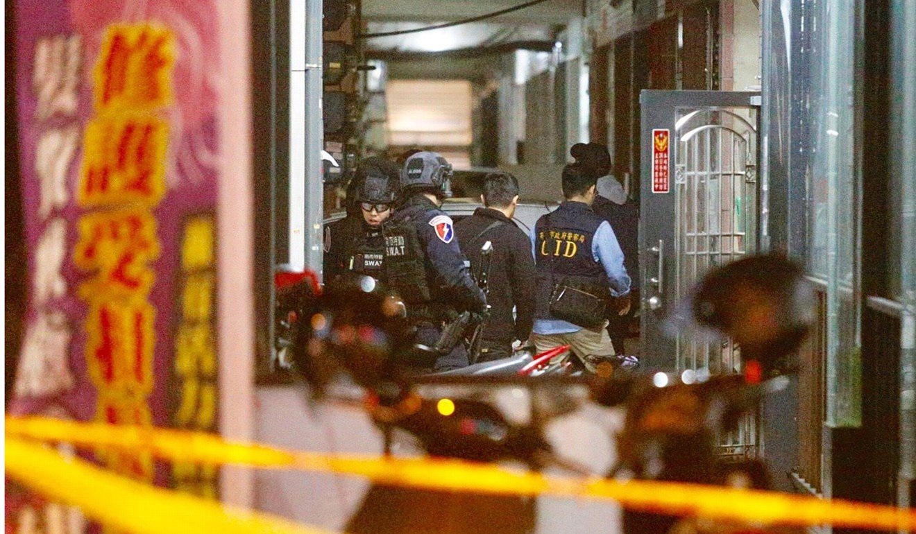 Taiwanese police shoot man suspected of planting explosive device at Kuomintang campaign office