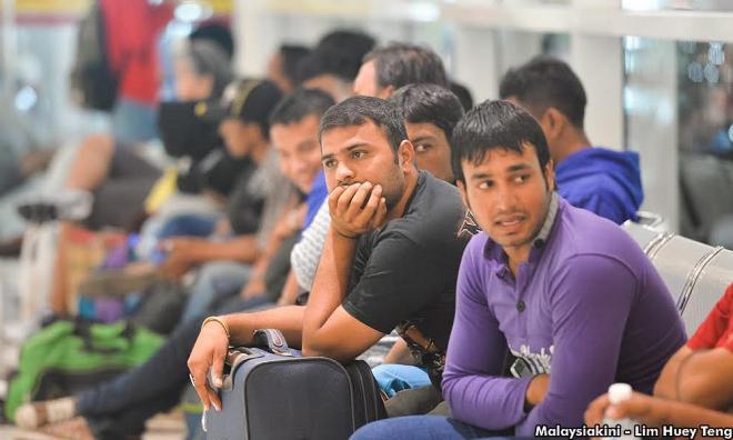 14万无证移工自愿返国,移民局放话明年即大逮捕