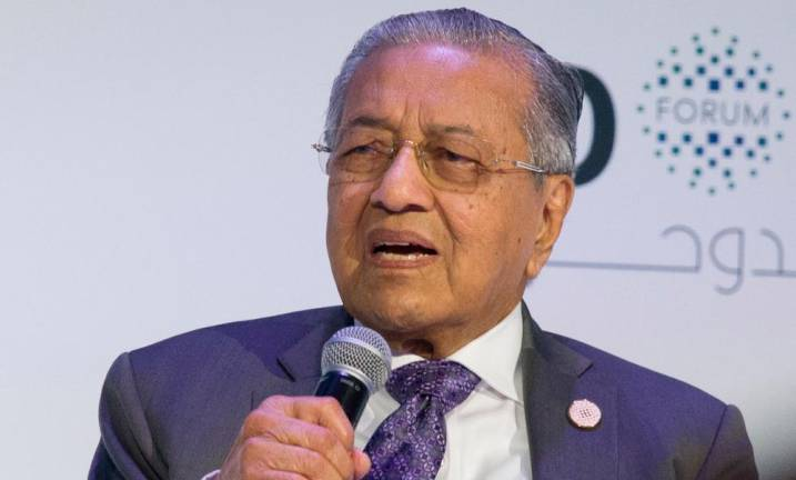 Dr M reiterates plan to step down after resolving problems left by previous govt