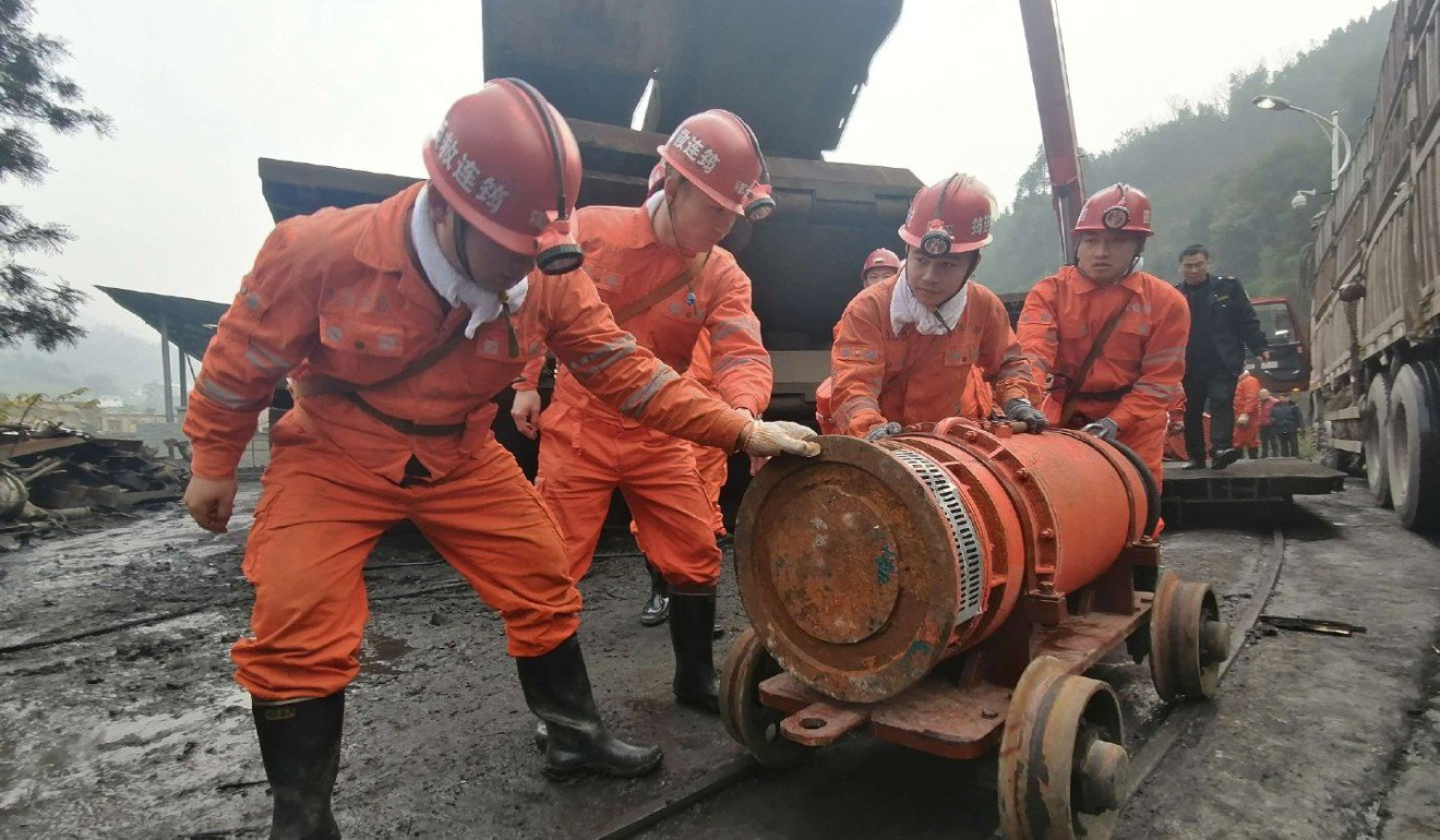 Flood at Chinese coal mine kills four, leaves 14 trapped