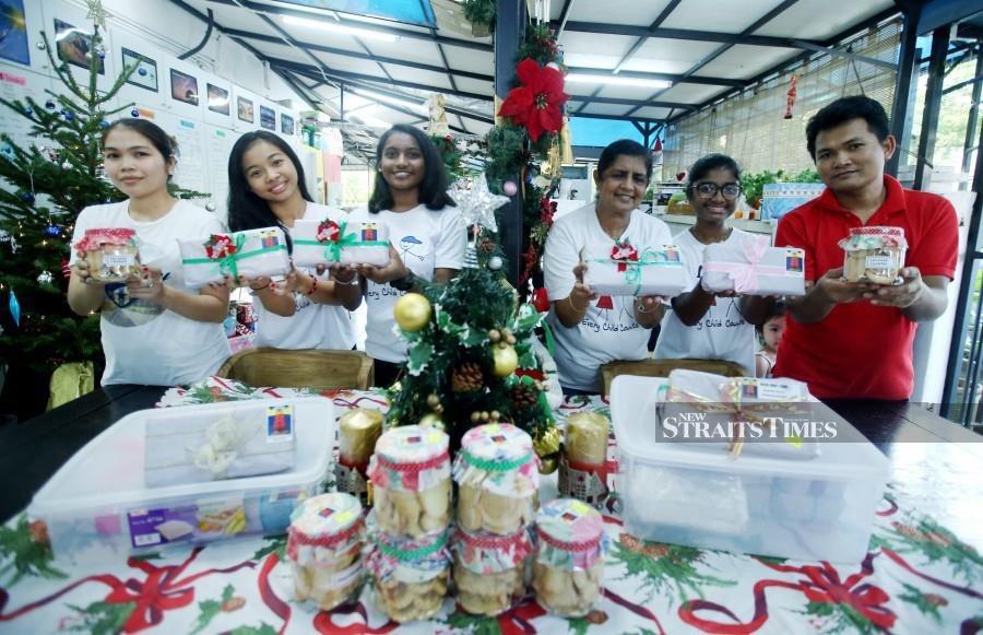 Children bake fruit cakes for X'mas to raise funds