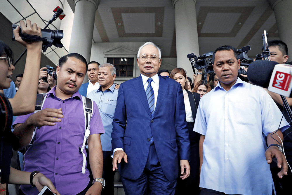 Najib Razak swears in mosque he did not order murder