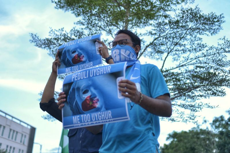At Chinese embassy's Xinjiang show, Muslim groups, PAS protest in support of Uighurs