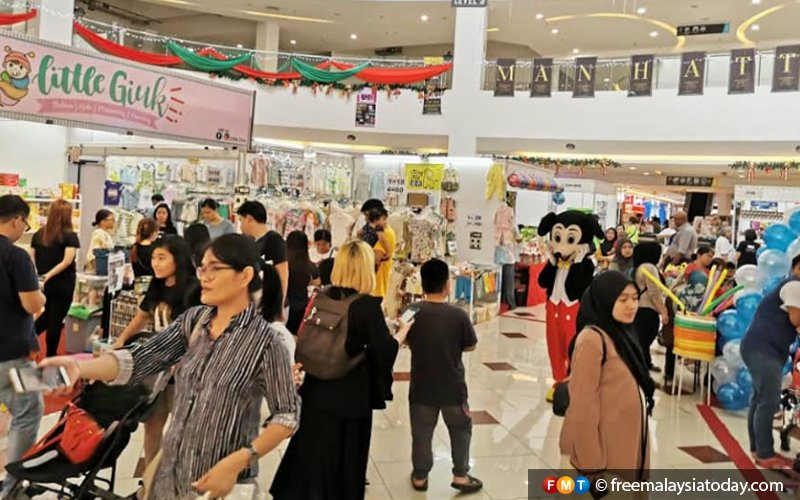 Sabahans tightening their belts, sticking to essentials for end-of-year blowout
