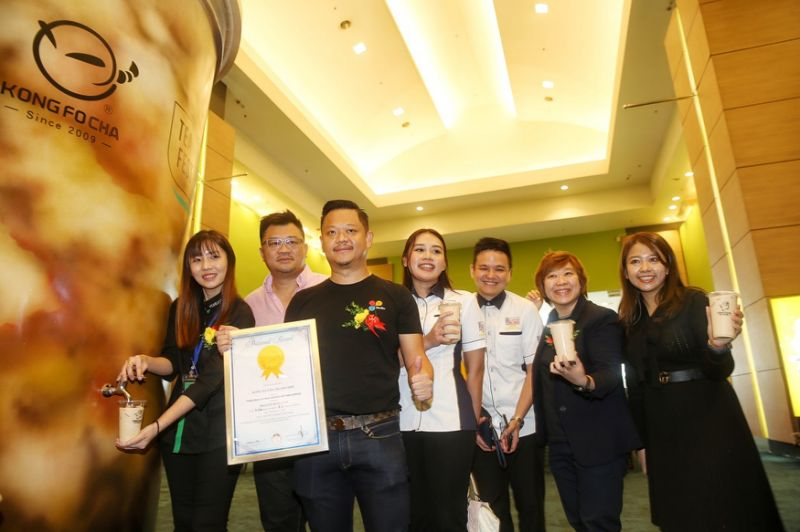 Towering 3.7m boba model cup dispenses milk tea for thirsty guests at KL exhibition