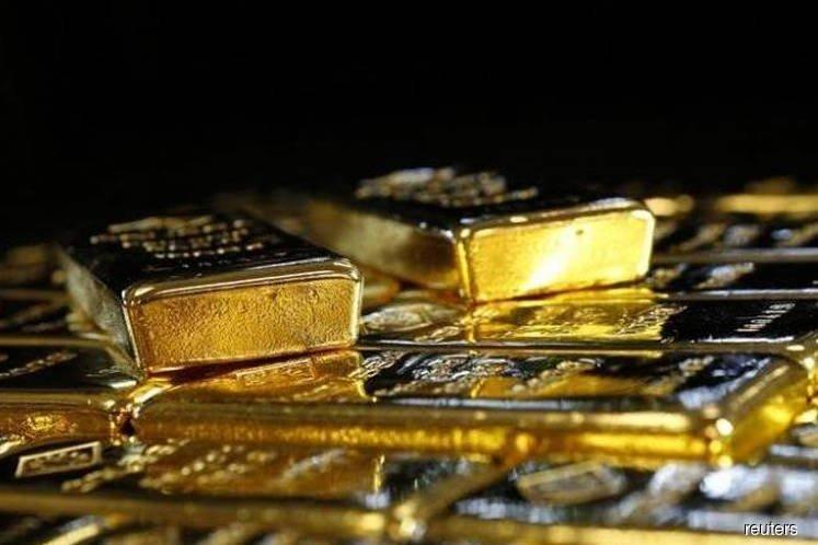 Gold rises 1% as virus risks boost rate-cut hopes