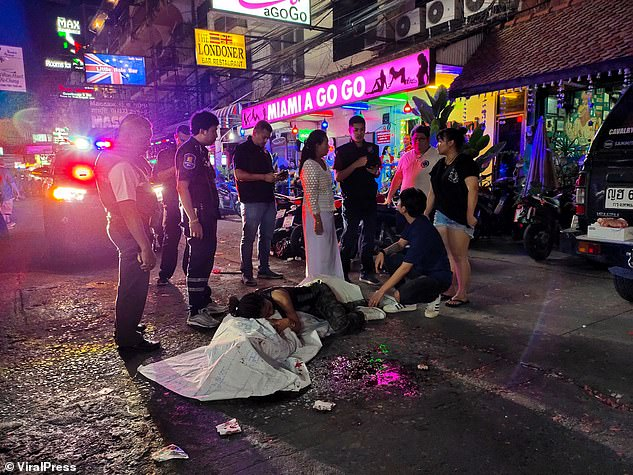 British man, 50, is killed on the stroke of midnight in front of his fiancee as firework he was trying to light explodes in his face amid New Year celebrations in Thailand