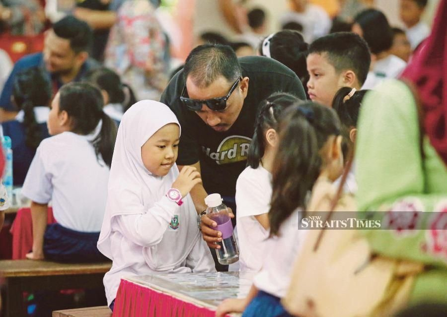 'Get more fathers to be present during first day of school'